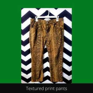 animal print textured corduroy pants